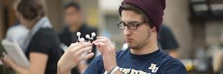 A student building a molecule