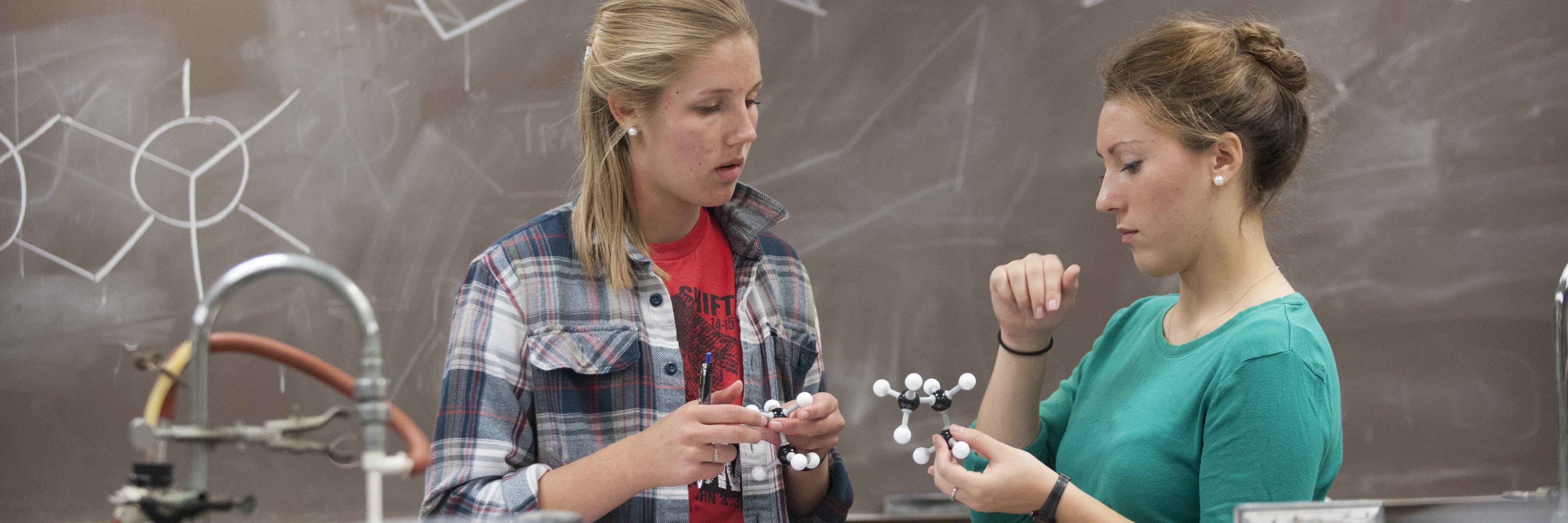 Students building a molecule