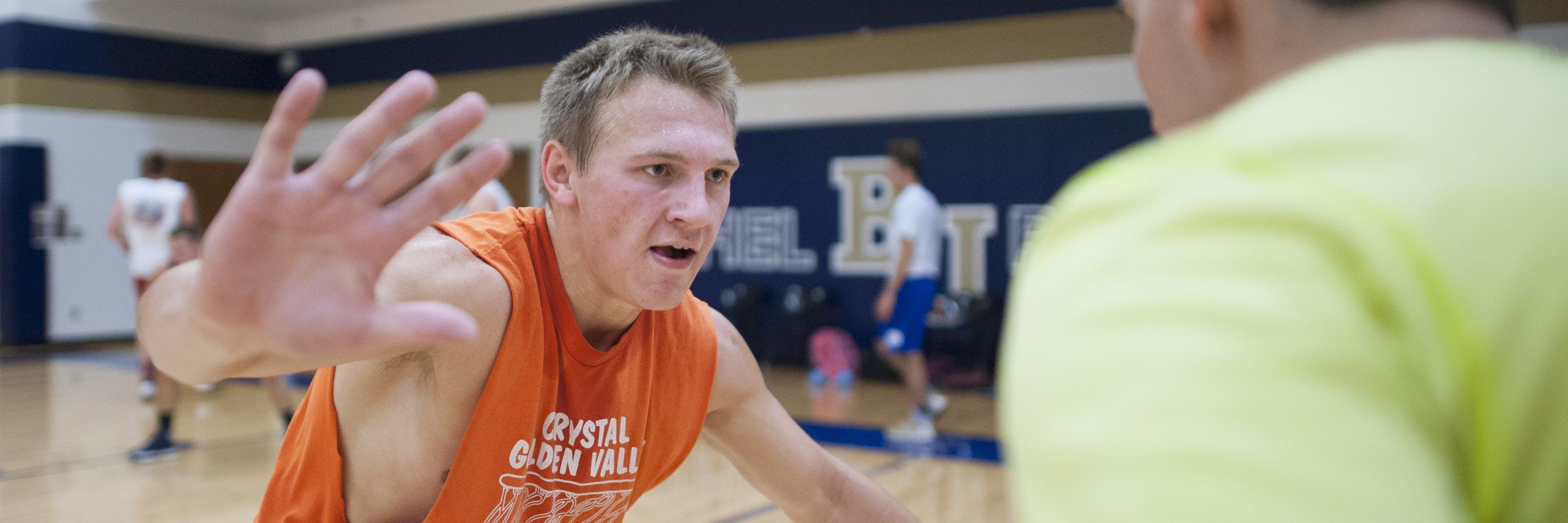 A student playing basketball