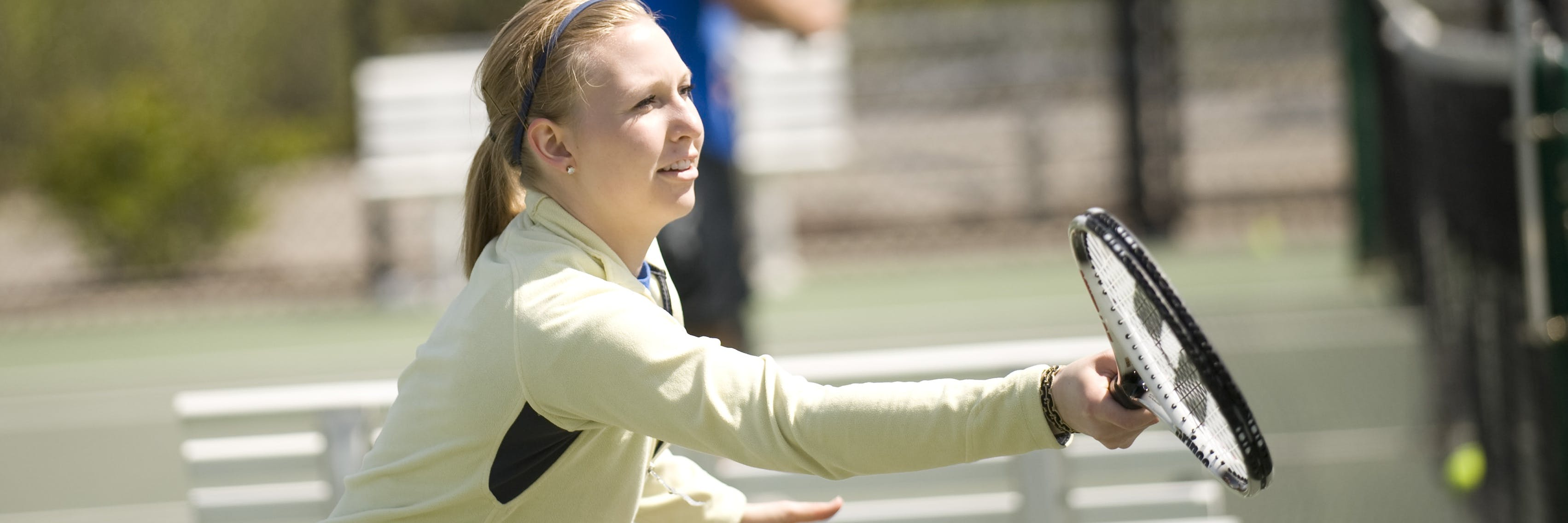 A student playing tennis