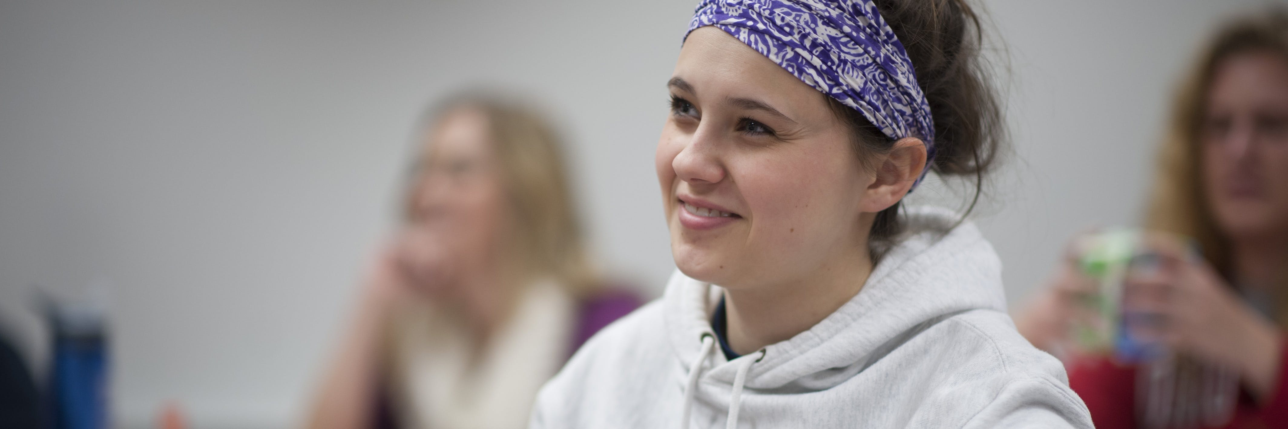 A student smiling in class