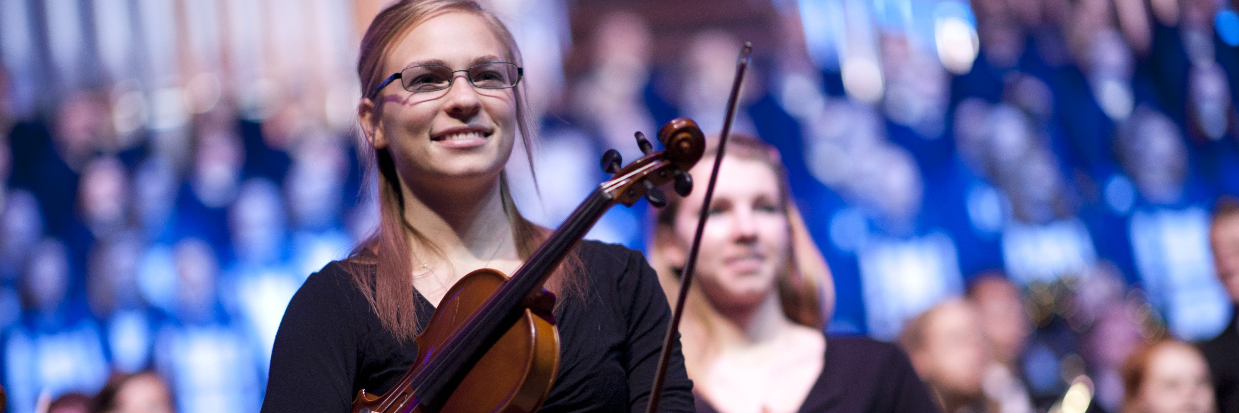 A student violinist at a festival