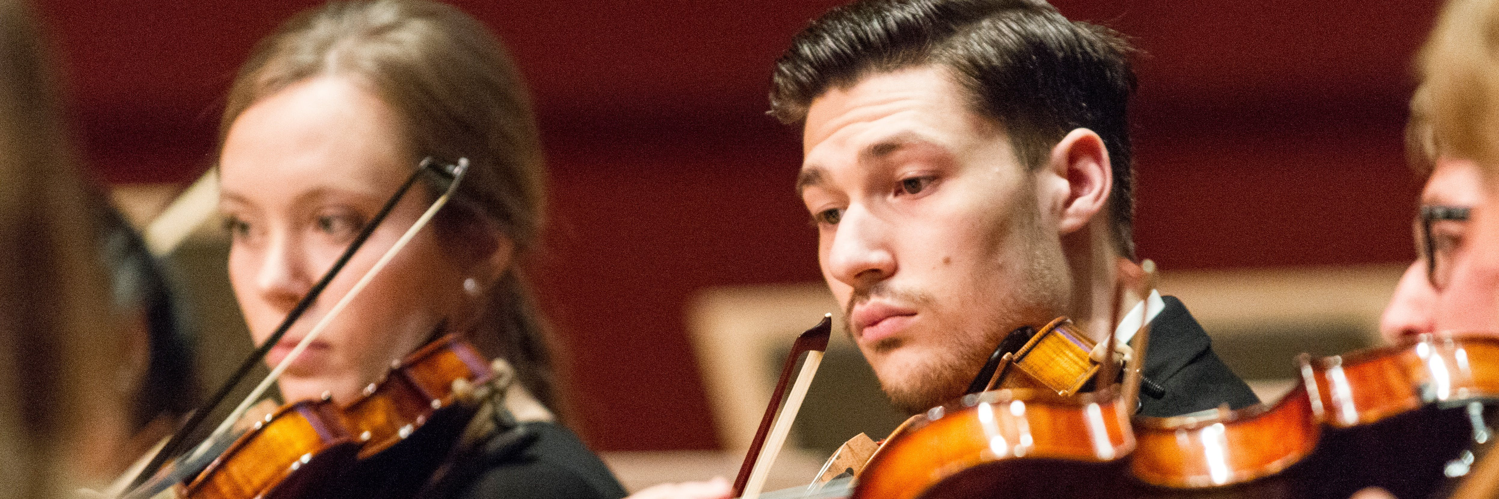 A student violinist performing