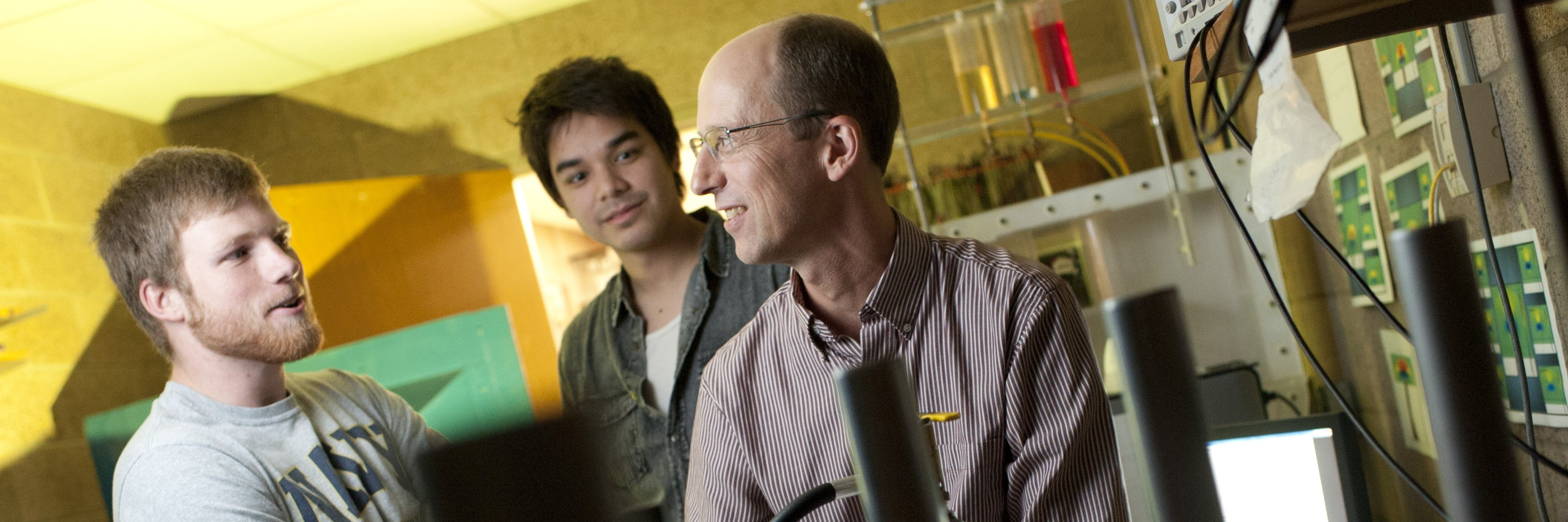 Student and a professor in the lab