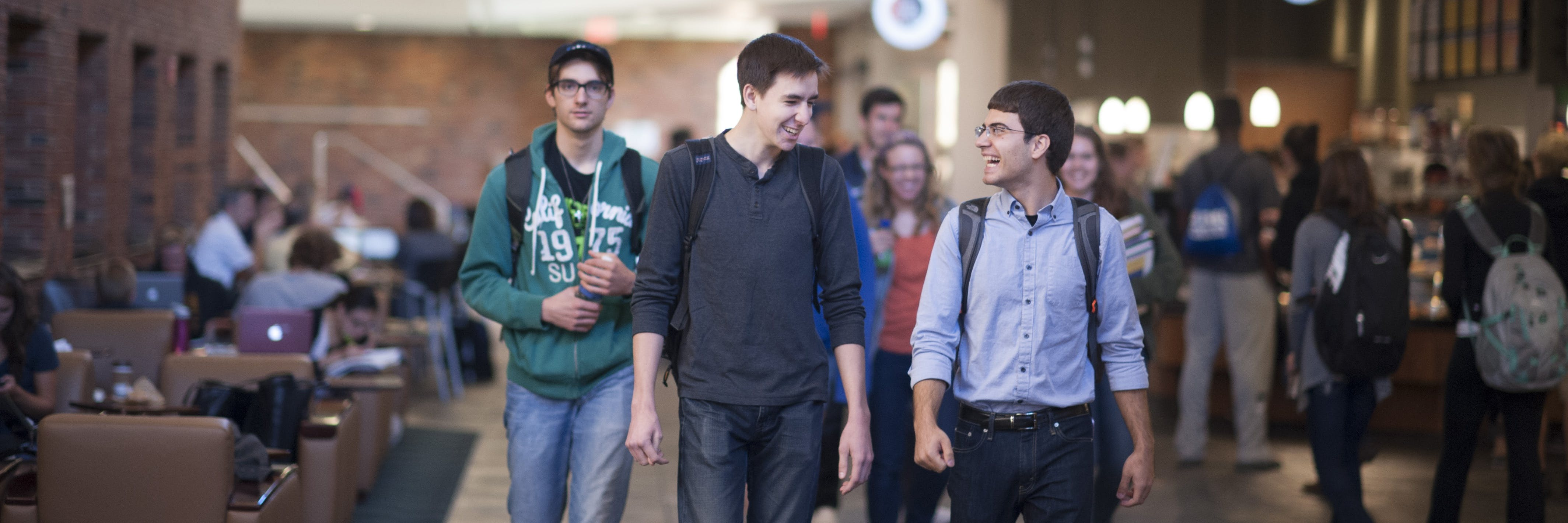 Students walking and chatting in the student commons