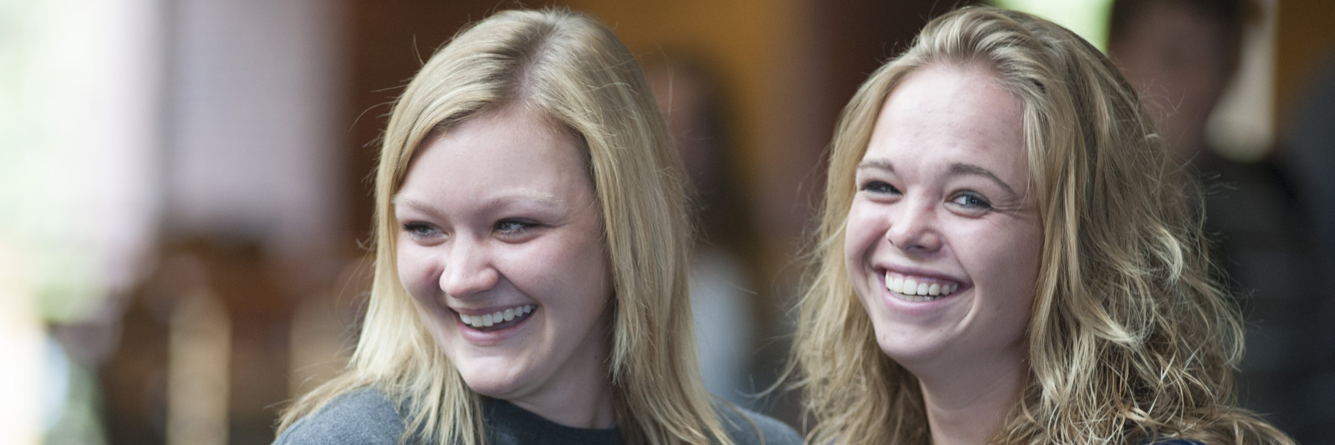 A couple students are smiling.