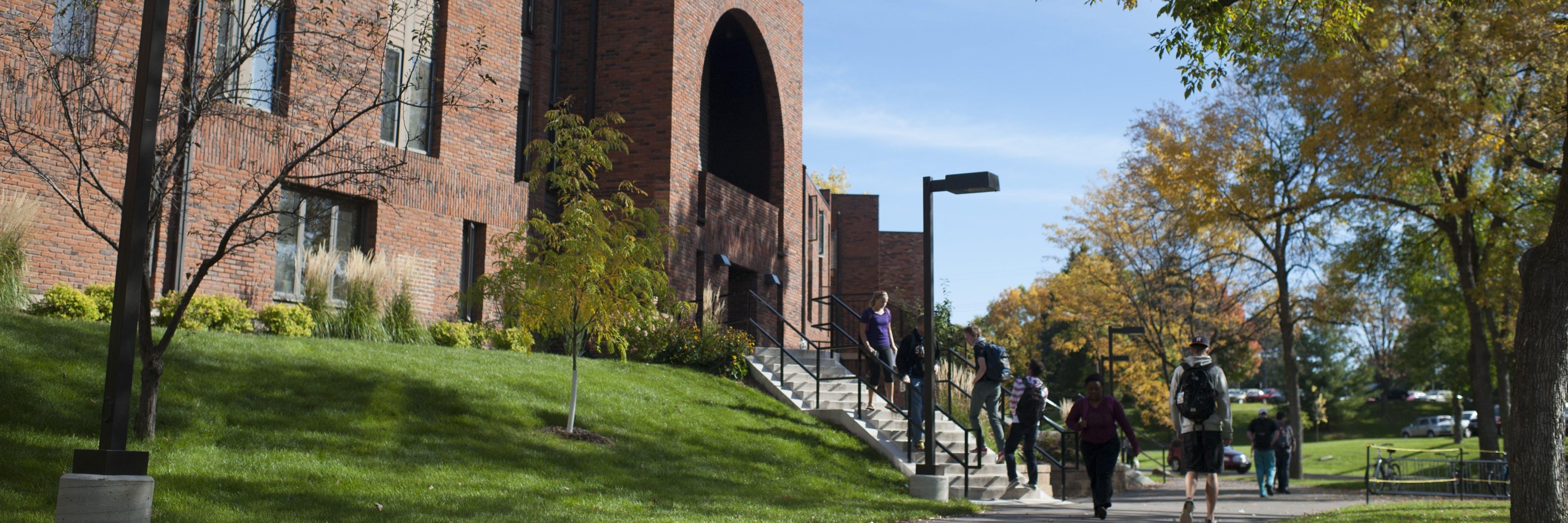 Students walk towards Nelson Hall.