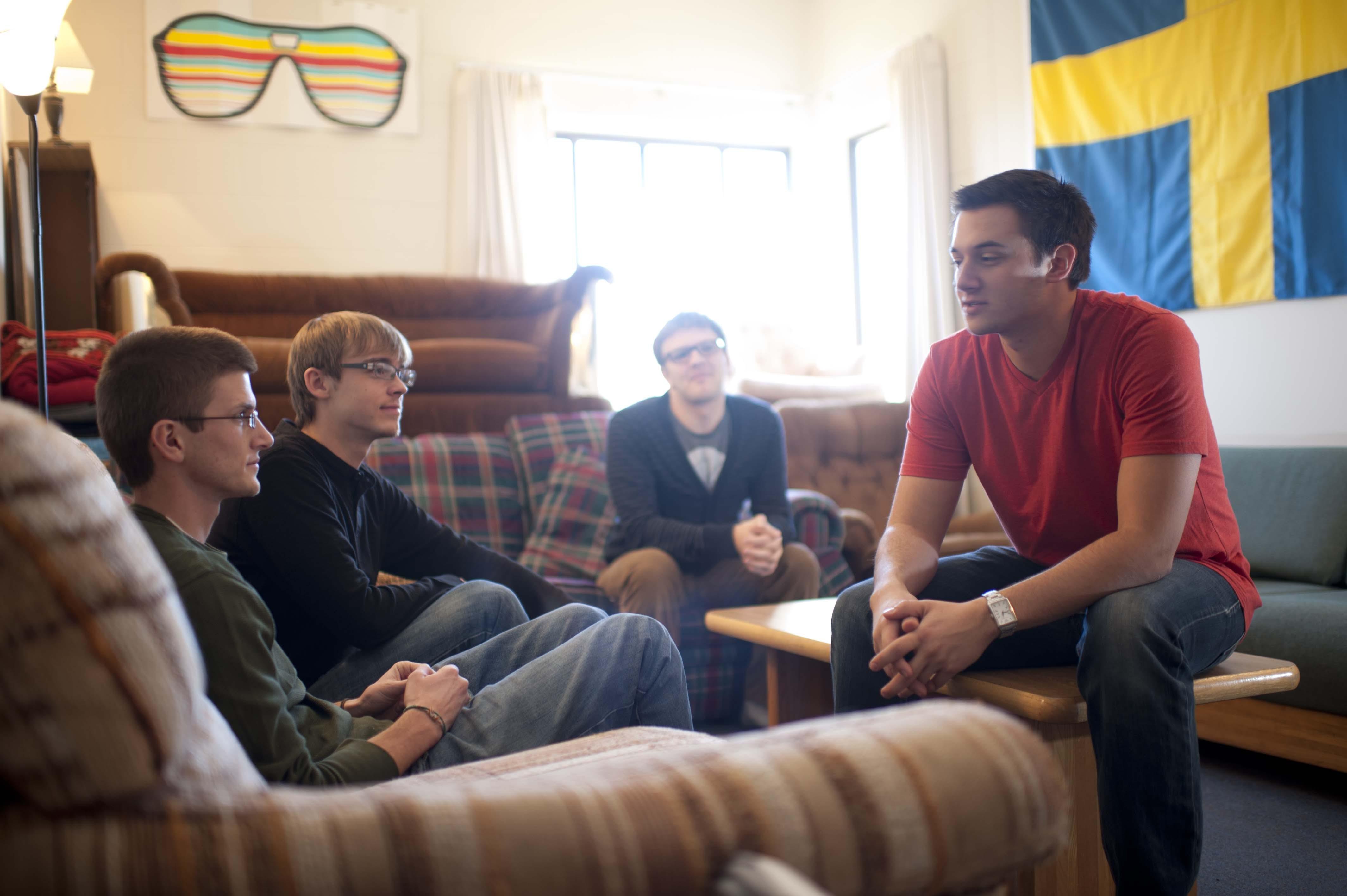 Bethel students talk in their dorm room