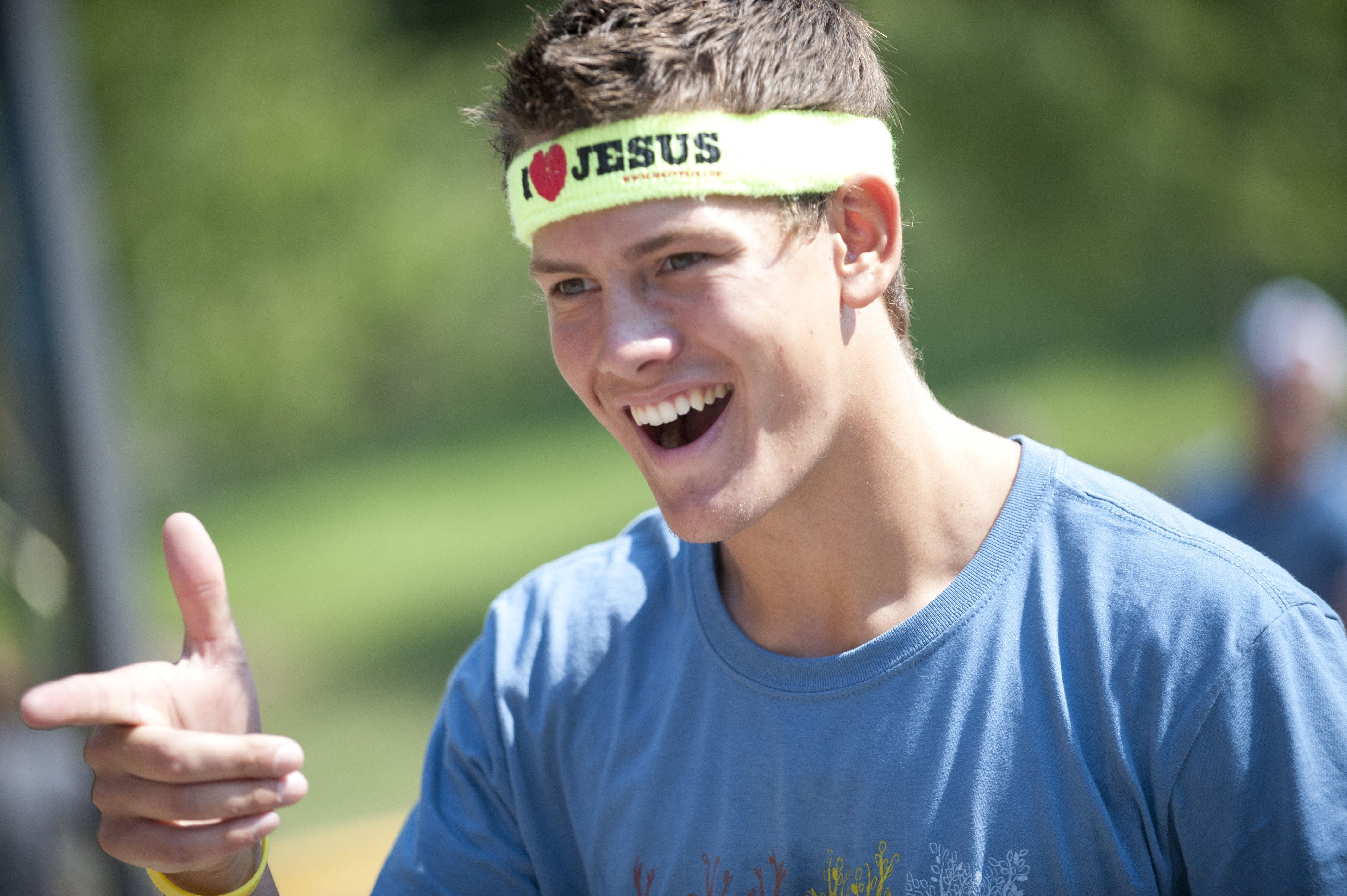 """Smiling student with """"I Love Jesus' sweat band."""